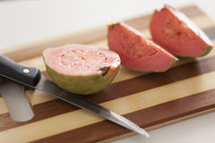 Guava fruit. On cutting board Royalty Free Stock Photo