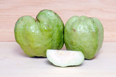 Guava fruit and half piece  on wood background. Guava fruit (Also called as, Psidium guajava, lemon guava, guayaba, Arawak guayabo, Subergine, common guava)  on Royalty Free Stock Image