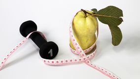 Guava fruit size tape measure Stock Photo