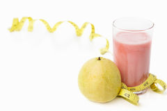 Guava and juice with measuring tape Stock Image