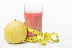 Guava and juice with measuring tape Royalty Free Stock Photo