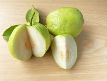 Guava slices, delicious fresh fruit, wooden background, high vitamin c stock photos