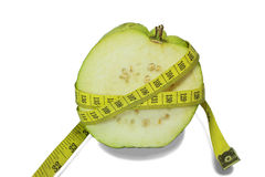 Guava with measuring tape. Half guava with measuring tape ,healthy concept royalty free stock image