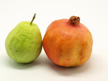 Guava and pomegranate. A pomegranate and a guava isolated on the white background Royalty Free Stock Image