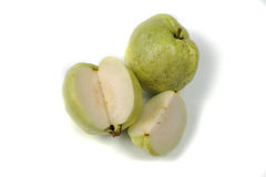 Guava tropical fruit whole and cut on white background Stock Photos