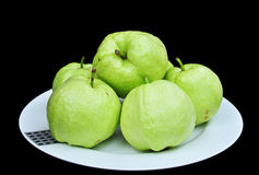 Guava on white dish. On black background,Thailand stock photos