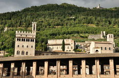 Gubbio city overview. With palazzo dei consoli, palazzo podesta and Basilica of SantUbaldo at sunset Stock Photos