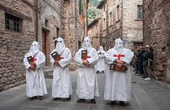 Gubbio Gubbio, Italy, the traditional procession of Friday of Easter week. Gubbio, Italy, the traditional procession of Friday of Easter week, boys preparing Stock Photos