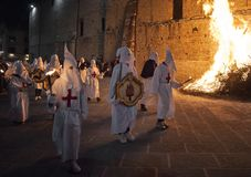 Gubbio Gubbio, Italy, the traditional procession of Friday of Easter week. Gubbio, Italy, the traditional procession of Friday of Easter week, boys preparing Royalty Free Stock Photos