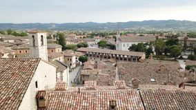 Gubbio, one of the most beautiful small town in Italy. Aerial view of the village from the upper square. Sunset time stock video footage
