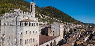 Gubbio, Italy. Drone aerial view of the city center, main square and the historical building called Palazzo dei Consoli Royalty Free Stock Photo
