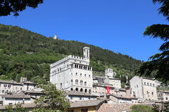 Gubbio in Umbria with Palazzo dei Consoli. Medieval Town Gubbio in Umbria-with Palazzo dei Consoli and Basilica of St. Ubaldo on the hill Stock Image