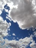 Gubjący w chmurach Obraz Royalty Free