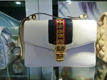 Gucci bags at window display. Gucci bags on display at a pre-own reseller store in Singapore stock photo