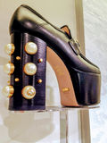 Gucci black platform women shoes with pearl embellishments. Displayed iat Saks Fifth Avenue store in Toronto Royalty Free Stock Photo