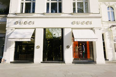 Gucci fashion company brand. BERLIN, GERMANY - MAY 11, 2017: Gucci fashion company brand trademark logo on store front at famous Kurfuerstendamm in Berlin royalty free stock photography