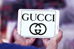 Gucci logo. Logo of fashion company gucci on samsung tablet stock photo