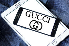 Gucci logo. Logo of global fashion company gucci on samsung mobile phone on samsung tablet stock images