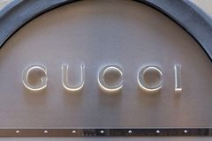 Gucci logo on Gucci`s shop. Florence, Italy - OCTOBER 25, 2018: Gucci logo on Gucci`s shop. Gucci is an international italian clothing company stock photography