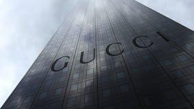 Gucci logo on a skyscraper facade reflecting clouds. Editorial 3D rendering. Gucci logo on a skyscraper facade reflecting clouds. Editorial 3D stock images