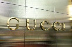Gucci logo stainless sign. Famous luxury brand for fashion world stock photo