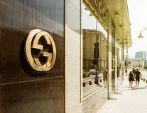 Gucci logotype on fashion flagship store. BUCHAREST, FRANCE - APR 1, 2016: Gucci sign logo on fashion store official boutique flagship store in Bucharest. Gucci royalty free stock photography