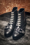Gucci men brogue black leather boots with very fashionable buckle Stock Photo