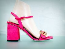 Gucci pink sandals on mannequin foot. Bright pink sandal by Gucci on mannequin foot Stock Photography