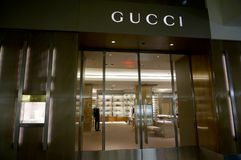 Gucci store in Ala Moana Mall. Honolulu - November 26, 2015: Gucci store in Ala Moana Mall. Gucci is an Italian luxury brand of fashion and leather goods. Gucci royalty free stock photo