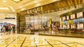 Gucci store. In Shanghai city, China.Gucci, the Italian fashion brand, was founded by Gucci o Gucci in Florence, Italy, in 1921. Gucci`s products include royalty free stock images