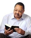 gud s som studerar ord Arkivbild