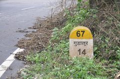 Gudalur milestone on NH 67 Royalty Free Stock Photography