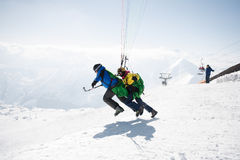 Gudauri, Georgia - March 6, 2017. Winter paragliding in caucasus mountains over high peaks and valley Stock Photography