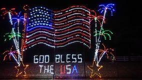 Guden välsignar USA arkivbild