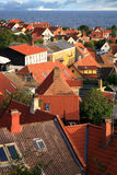 Gudhjem, Bornholm, Denmark. Panorama of picturesque small town Gudhjem with red roofs by early morning, Bornholm, Denmark stock photography
