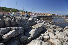 Gudhjem and its small harbour. Bornholm, Denmark. Gudhjem is a popular turist destination. On the right side there are 3 sets of white chimnies from Herring stock photos