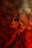 Gudinna av röd Grunge för medkänslabronsstaty Royaltyfri Foto