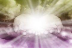 gudomliga händer Arkivbild