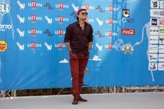 Gue Pequeno De zanger van clubdogo Stock Fotografie