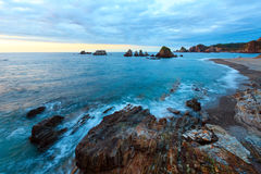 Gueirua beach at evening. Asturias, Spain. Evening Atlantic ocean coastline landscape. Beautiful Gueirua beach with sharp islets. Asturias, Spain stock photo