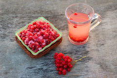Guelder rose jam, fresh viburnum and tea viburnum on old wood background Royalty Free Stock Photography