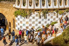 Guell park in Barcelona. BARCELONA, SPAIN - August 17, 2017: Close-up view on the Dragon stairway with tourists in Guell park, famous public park with gardens Royalty Free Stock Photo