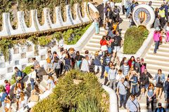 Guell park in Barcelona. BARCELONA, SPAIN - August 17, 2017: Close-up view on the Dragon stairway with tourists in Guell park, famous public park with gardens Royalty Free Stock Images