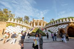 Guell park in Barcelona. BARCELONA, SPAIN - August 17, 2017: View on the Dragon stairway and terrace with tourists in Guell park, famous public park with gardens Royalty Free Stock Images