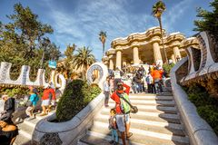 Guell park in Barcelona. BARCELONA, SPAIN - August 17, 2017: View on the Dragon stairway and terrace with tourists in Guell park, famous public park with gardens Royalty Free Stock Photos
