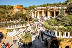 Guell park in Barcelona. BARCELONA, SPAIN - August 17, 2017: View on the Dragon stairway and terrace with tourists in Guell park, famous public park with gardens Stock Photos