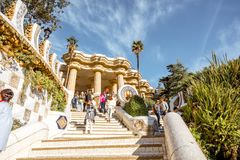Guell park in Barcelona. BARCELONA, SPAIN - August 17, 2017: View on the Dragon stairway and terrace with tourists in Guell park, famous public park with gardens Royalty Free Stock Photography
