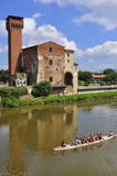 Guelph Tower of the old Citadel , Pisa , Italy. With a rower boat passing by Stock Images