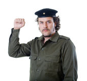 Guerilla with beret and communist star. Mid-aged man in authentic 1950s/60s military uniform shirt and beret hat, holding a sign, ready for the next guerilla Royalty Free Stock Photo