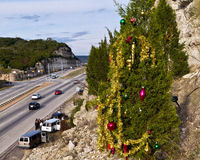 Guerilla christmas tree above Austin highway. Not easily accessible, one of the roadside or guerilla christmas trees along the 360 Capital of Texas Highway in Royalty Free Stock Photo